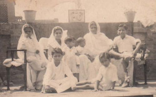 Left to right, back row: Sisters Nirmal and Kamla, mother with Vijay brother in her lap, cousin Krishan Gopal Anand. Middle row: Brother Ashok. Front row: Brother Inder and his friend Rameshwar. Just before the partition of India.