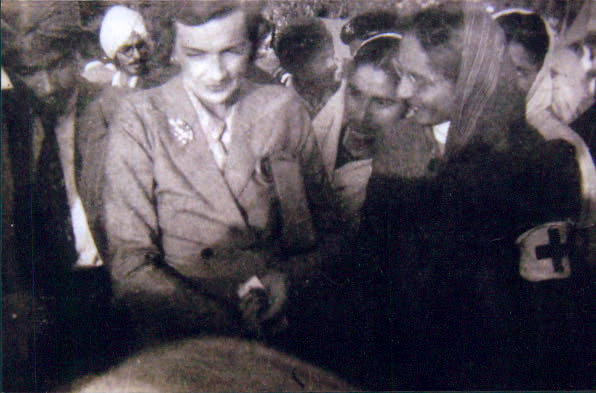 Lady Edwina Mountbatten (left) at the refugee camps, with Indira Anand (centre) and her cousin, Usha Bhandari (right). Note the Red Cross armbands.