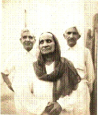 Centre, my mother (Biji)\; behind, my father (Pitaji), and his brother.