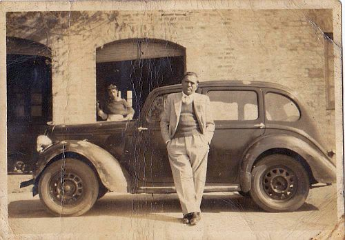 My father-in-law, S.N. Sikand, in front of his old model car, with his older daughter at the back.