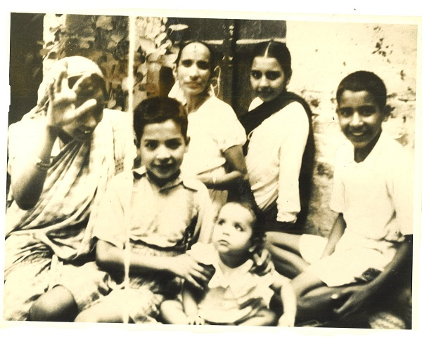 Front: Jatinder (6 years old) holding first child, Shashi, of his older sister, Prem Behnji (back left). Others at back: my mother, my sister Santosh, and my younger brother, Satinder.