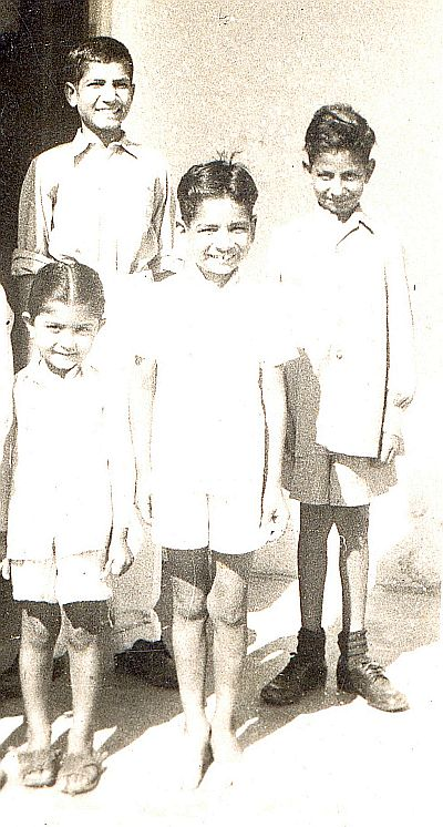 L to R: Madhu Khera (cousin), Juginder, Krishan (brother) Behind Virinder (brother). About 1952.