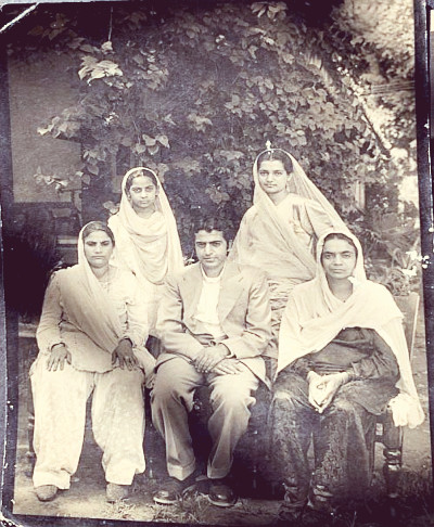 L to R: Front: unknown, my father's maternal uncle (Mama Ji) Lachman Das, my father's mother Vidyawati. Back: unknown, my bua Ms. Sarla now bhakti Premanand. Bannu. Circa 1945.