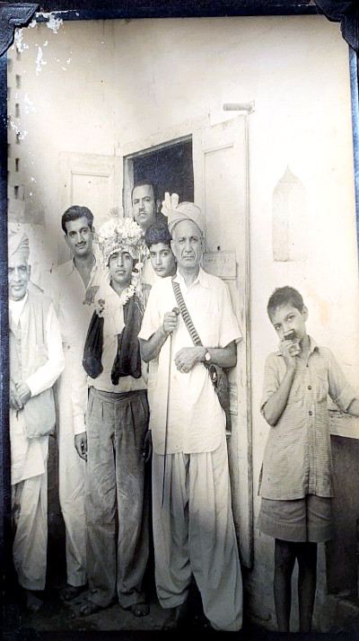 My grandfather on right with stick in his hand, Harbans Lal Banga (my uncle) second from left, Lachman Das Ratra (my father's maternal uncle) wearing Sehra. Bannu. Circa 1940.