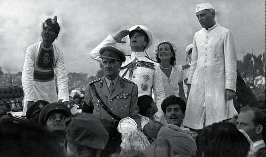 Lord Mountbatten saluting the Indian flag, with Lady Mountbatten and Nehru to his left.