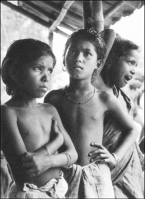 Dhop Dhopi children as they watched the downpour. 24-Paraganas, West Bengal. Mid-1960s.