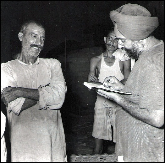 Khushwant Singh, right, as Editor of Yojana, journal of the Planning Commission. In Bhakra village, a villager (on the left) told Khushwant that he was aware, even as a young man, that one day a great dam would come up near his village. The Bhakra dam gets its name from this village, which was submerged in the waters of the Sutlej after the dam was built. (Photo: T.S. Nagarajan)