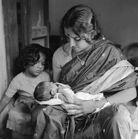 Meenakshi with Vasanti (on lap), 11 days old. Kalyani, 3 years old, look on. (Pondicherry)