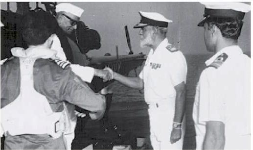 From left: Helicopter Pilot, Prime Minister Desai, Vice Admiral Awati, Captain Gupta. Arriving on INS Shakti, February 1979