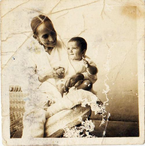 My frail mother, Beeji, (6 sons, 2 daughters) with one of her grandchildren. Early 1950s.
