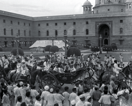 The ceremonial coach carrying Lord and Lady Mountbatten at a point between South Block (to the right) and North Block.